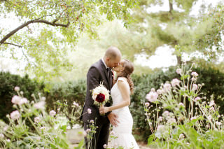 This Columbus Ohio bride and groom exchange a kiss at the Franklin Park Conservatory photographed by Red Gallery Photography.